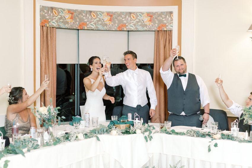Bride and Groom Cheers at Wedding Reception
