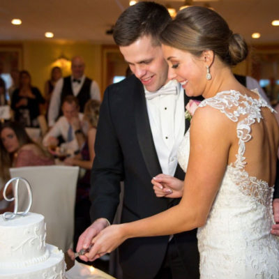 Allison and Tadd cutting their wedding cake