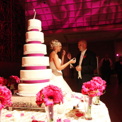 Bride and groom eating their wedding cake